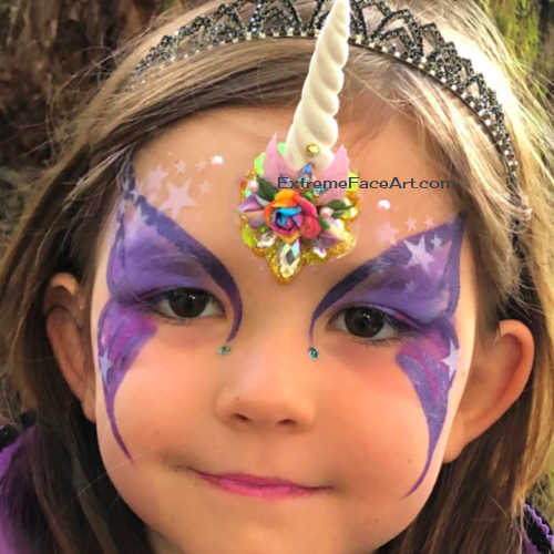Unicorn hace paitning bling on chiden for face painting in Sacramento